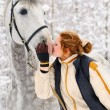 Girl and white horse in winter — Stock Photo #2650070