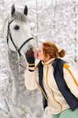 Girl and white horse in winter — ストック写真