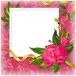 Stock Photo: White frame with flower and ribbon on th