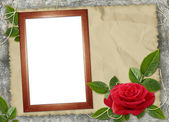 Wooden frame with red rose on the brown — Stock Photo
