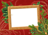 Wooden frame with spruce branches on the — Stock Photo