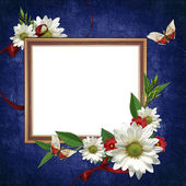 White frame with flowers and ribbons — Stock Photo