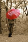The girl and an umbrella — Stock Photo