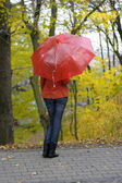The girl with a red umbrella — Stock Photo