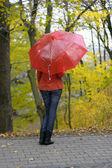 The girl with a red umbrella — Foto de Stock