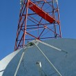 Satellite Dish and Radio Tower - Stock Photo