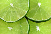 Isolated Lime Slices — Stock Photo