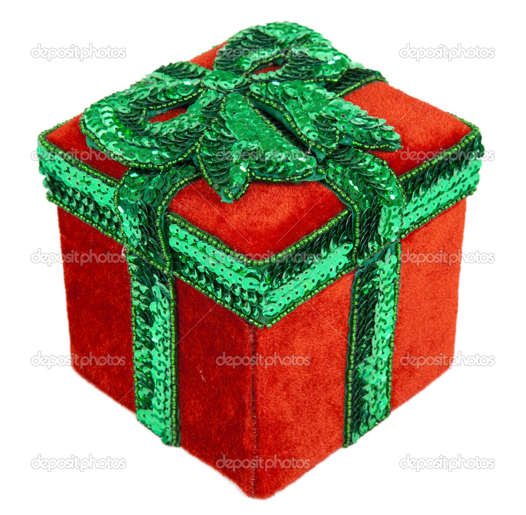 A red and green Christmas present box with a green bow on top of the lid.  Stock Photo #1385396
