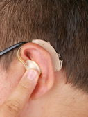 Wearing hearing aid — Stock Photo