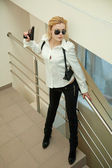 Beautiful girl with gun — Stock Photo