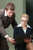 Businesswoman and businessman — Stock Photo