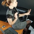 Girl-secretary is in an office - Stok fotoğraf