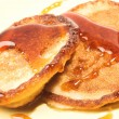 Two pancakes with maple syrup — Stock Photo