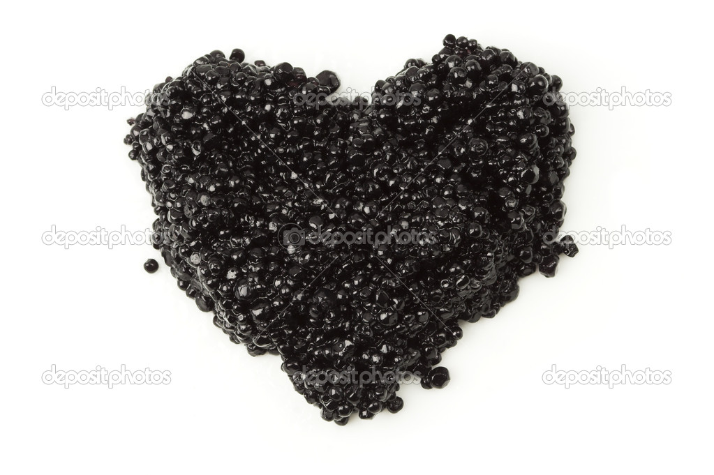 Heart of black caviar isolated on white. — Stock Photo #1382189