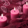 Three candles on purple cloth — Stok fotoğraf