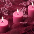 Three candles on purple cloth — Stock fotografie