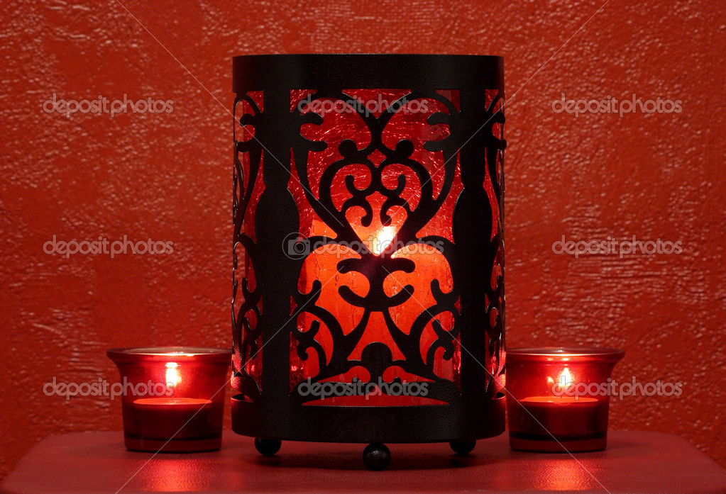 Red candles in red glass candleholders — Stok fotoğraf #1434424
