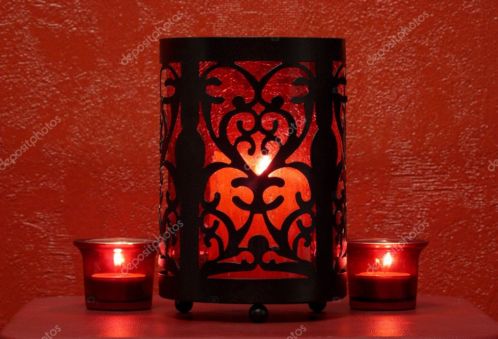 Red candles in red glass candleholders — Foto de Stock   #1434424