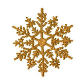 Gold glitter snowflake — Stock Photo