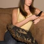 Beautiful teenage lady on phone — Stock Photo