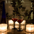 Late night wine by candlelight for two. - Stock Photo