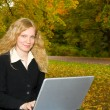 Stock Photo: Women with laptop studying in the park i