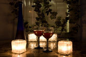 Late night wine by candlelight for two. — Stok fotoğraf