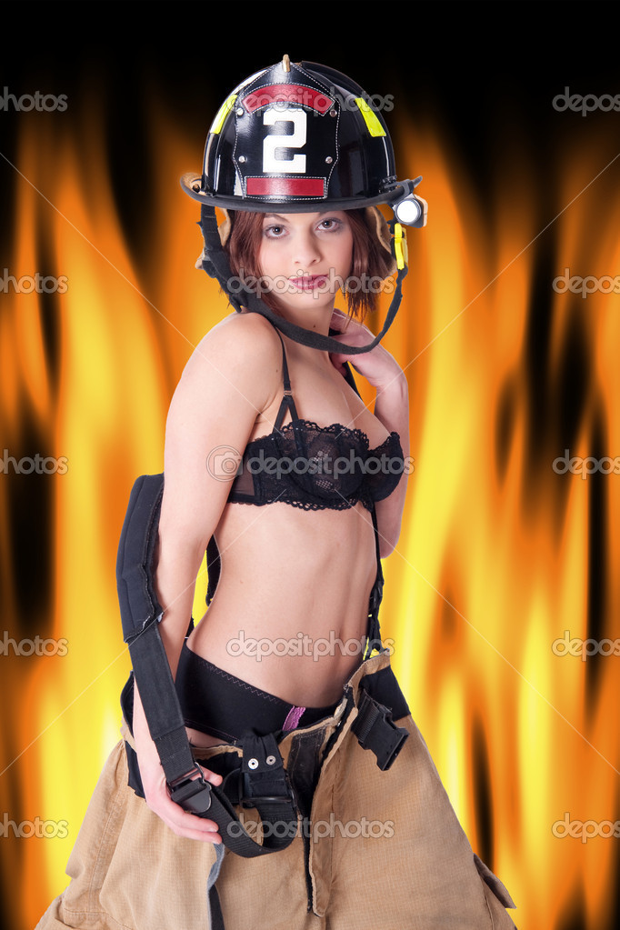 Sexy Female Firefighter in fire gear and bra — Stock Photo #1312031