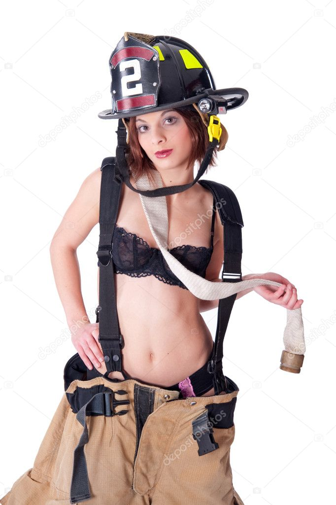 Sexy Female Firefighter in fire gear and bra — Stock Photo #1312065