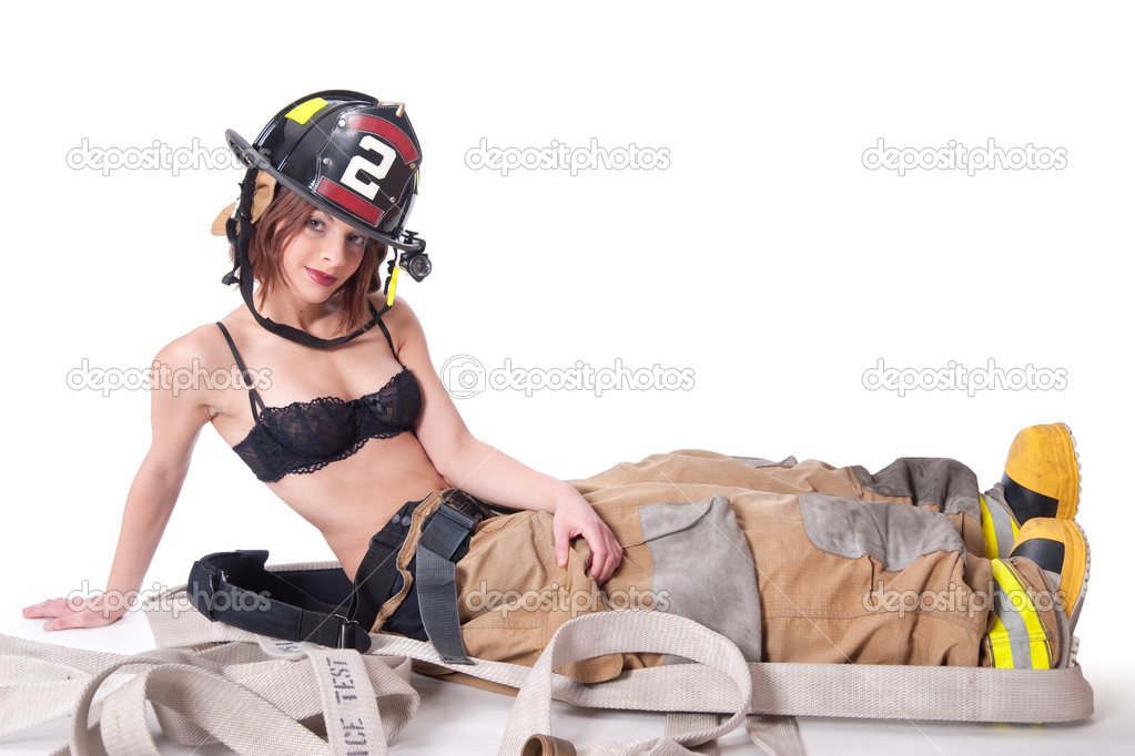Sexy Female Firefighter in fire gear and bra  Stock Photo #1312127