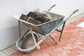 Old full wheelbarrow — Stock Photo
