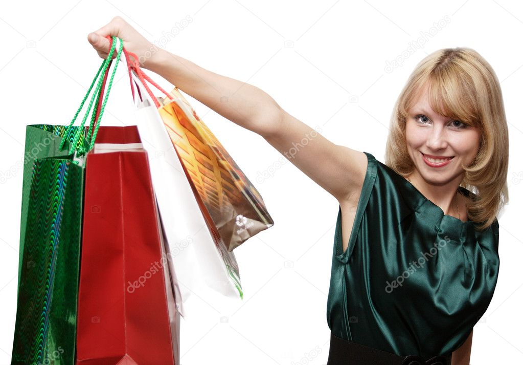 Happy smiling girl shopping with colored bags. Consumerism Concept.. Isolated over white background. — Stock Photo #1471173