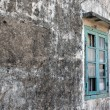 Stock Photo: Old broken window on grey wall