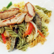 Stock Photo: Grilled chicken breast with fusilli