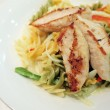 Stock Photo: Grilled chicken brest with fusilli