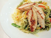 Grilled chicken brest with fusilli — Stock Photo