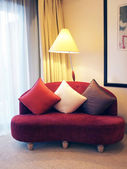 Red sofa in a living room — Stock Photo