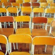 Chairs in secondary school hall — Stock Photo