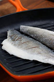 Seabass in griddle pan — Stock Photo