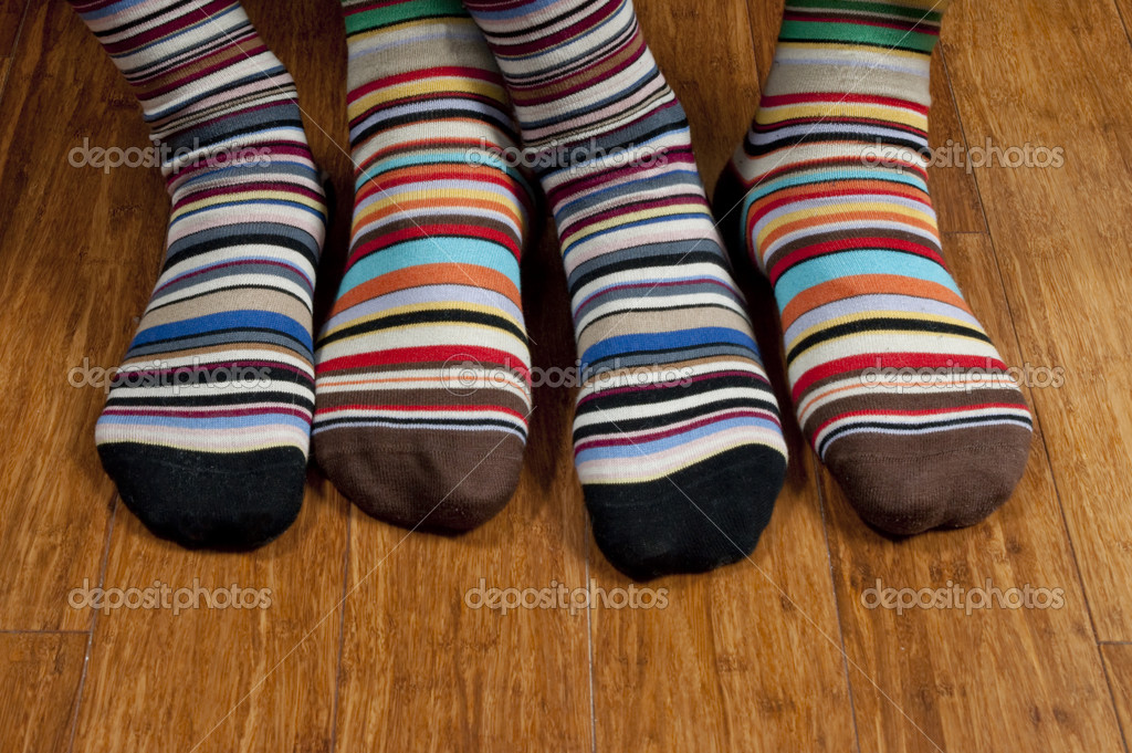 His and hers striped socks on wooden floor — Stock Photo #1921235