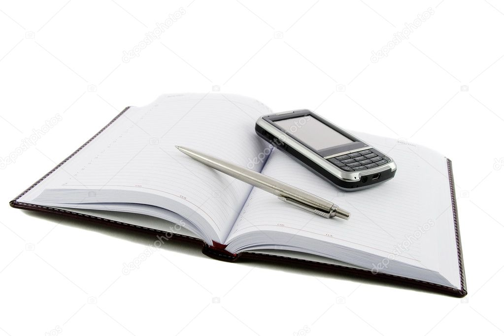 Close up notebook, pen and mobile phone on it isolated over white — Stock Photo #1387102