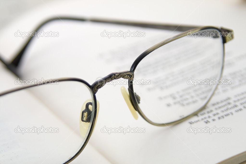 glasses on book - photo #41