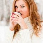 A beautiful girl drinking hot coffee — Stock Photo