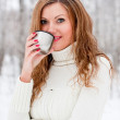 A beautiful girl drinking hot coffee — Stock Photo