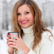 A beautiful girl drinking hot coffee - Stock Photo