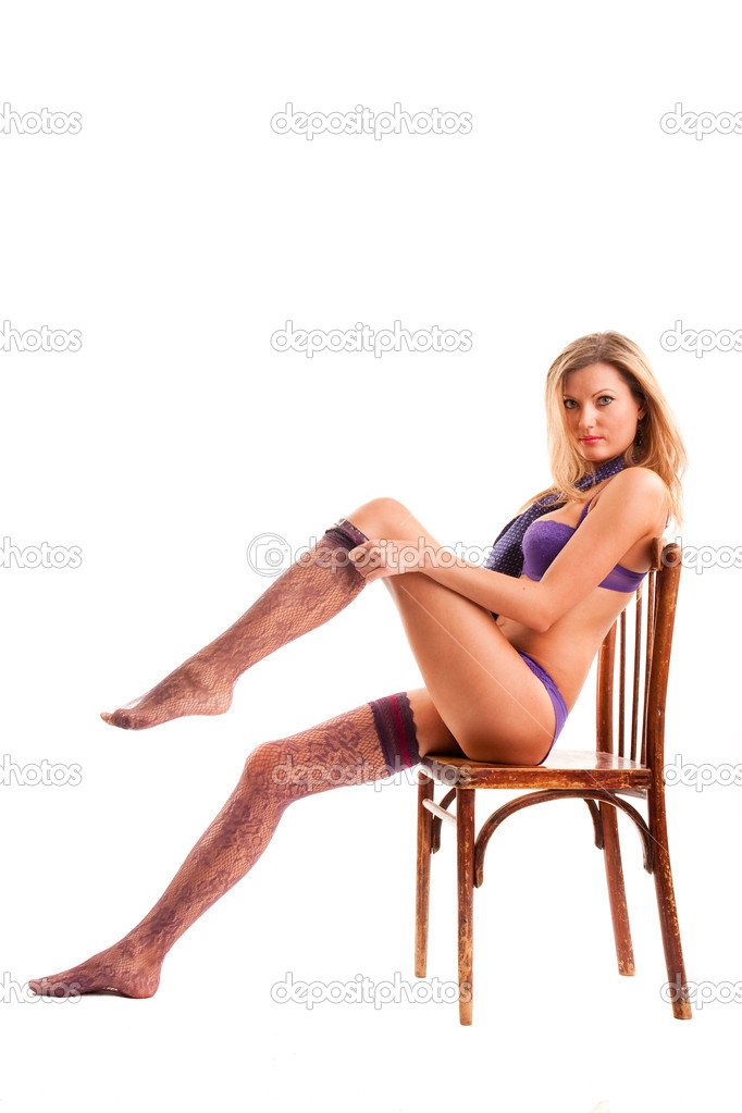Pretty woman on a chair — Stock Photo #1377566