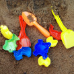 Toys in sandbox — Stock Photo