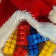 Building blocks on Santa Claus cap — Stock Photo
