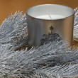 Fir tree and candle on gold background — Stock Photo