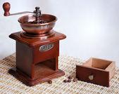 Coffee-grinder & ground coffee box — Stock Photo